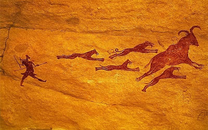 cacciatori primitivi con cani